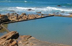 Close view of tidal pool at Ramsgate. Tidal pool with sea in background at Ramsgate, Kwazulu Natal Stock Photo