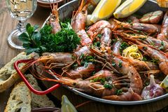 Close view of tiger prawn shrimps roasted with lemon garlic and wine Royalty Free Stock Photo