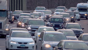 Close view of trucks and cars in traffic. A close view of trucks and cars in traffic stock footage
