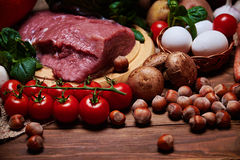Close view at vegetables and raw meat on a burlap Stock Photos