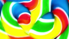 Close view of a vibrant lollypop spinning fast in circles stock video footage