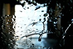 Close view of water and detergent on windscreen or windshield of car in car wash stock photos