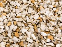 Wet floor of white pebbles, and light brown. Close view of wet floor of white pebbles, and light brown, after summer rain Stock Photos