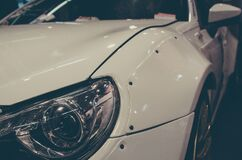 Close View of White Cars Left Headlight Royalty Free Stock Photography