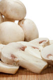 Close view of whole and sliced mushrooms Stock Images