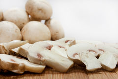 Close view of whole and sliced mushrooms Stock Photo