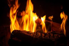 Close view of a wooden trunk in a fireplace royalty free stock photos