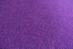 Close view of woollen violet knit fabric. Close view of woolen violet knit fabric Royalty Free Stock Photos