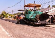 Close view on the workers and the asphalting machines, Workers making asphalt at road construction stock photo