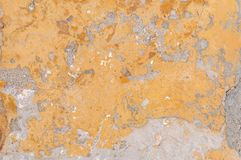 Close view of yellow building wall cracked and broken architecture. Concrete texture Stock Photo