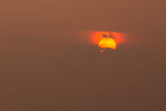 Close View Of Yellow Sun Disk With Red Glow Around, Partly Cover Royalty Free Stock Photography