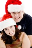 Close view of young couple with christmas hat Royalty Free Stock Image