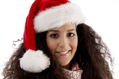 Close view of young woman wearing christmas hat Royalty Free Stock Images
