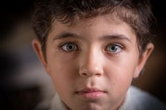 Close viewing portrait of cute young boy with expressive eyes.  royalty free stock image