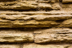 Close wall III. Detail of an ancient eroded stone wall Stock Photography