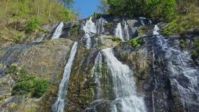 Close Wide Panorama Waterfall among Tropical Forest. Close wide panorama of powerful waterfall among rocky slopes in Vietnamese tropical highlands stock footage