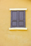 Close the window background color to a yellow wall royalty free stock photo