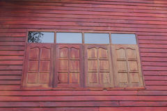 Close the window. Red wood carved window of countryside house Stock Photography
