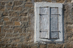 Close window on a stoned wall Royalty Free Stock Photos