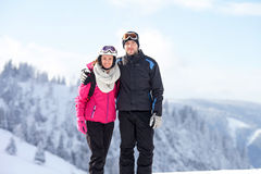 Close winter portrait of brother and sister, skiing stock photos