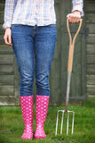 Close Of Woman Wearing Pink Wellingtons Holding Garden Fork Royalty Free Stock Photography