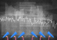 Female hands in a row holding blue paper trumpets against graphs background Stock Photo