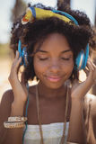 Close of young woman with eyes closed listening music Royalty Free Stock Images
