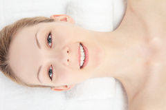 Close your eyes woman. Young Caucasian woman seen from above on a white background Stock Photos
