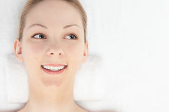 Close your eyes woman. Young Caucasian woman seen from above on a white background Stock Images