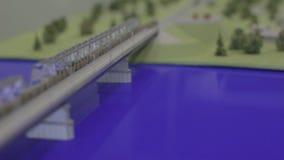 Closeap Transportation Bridge and Beautiful Park Model. SALEHARD, YAMAL-NENETS/RUSSIA - JANUARY 14 2013: Closeap future modern transportation bridge and public stock video