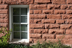 Closed. Single white window in a red brick wall Royalty Free Stock Photo