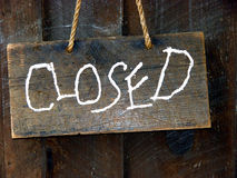 Closed. Sign made from wood hung by a rope Royalty Free Stock Image