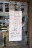 We are closed. Hand-made closed sign ona Vancouver Sushi restaurant royalty free stock photo