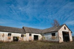 Closed abandoned livestock farm building at coutryside. Abandoned livestock farm building at rural countryside closed due to payment delay. big barn granary royalty free stock photo