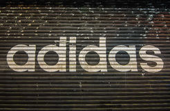 A closed Adidas` shop at night outside the store. Hong Kong - December 7th, 2016. a closed Adidas` shop at night outside the store Royalty Free Stock Photo
