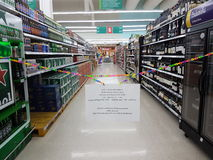 Closed alcohol area shelves in big supermarket Royalty Free Stock Image
