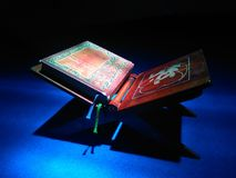 Closed Alquran on it& x27;s place. Al-Qur& x27;an with light from above. Can be used for ramadhan picture especially nuzulul Qur& x27;an moment Royalty Free Stock Photos
