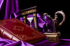 Closed Ancient Book with Treasurs on Satin Stock Photography