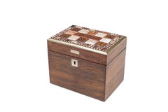 A Closed Antique General Purpose Wooden with Tiled Lid. A cut-out of a vintage general purpose box with lock and ornamental tile laced lid stock image