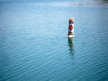 Closed Area Buoy. Closed Area warning buoy floating on the water Royalty Free Stock Photo