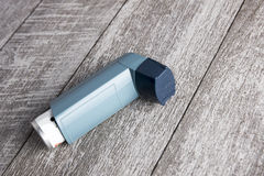 Closed asthma inhaler. Close up photo Stock Images