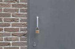 Closed Backdoor with padlock. Closed Backdoor with a steel padlock royalty free stock photography