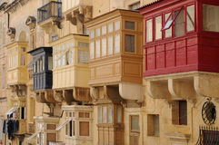 Closed balconies. The traditional closed balconies of  houses of Valletta, capital city of Malta, Europe.  Malta is UNESCO World Heritage Site Royalty Free Stock Photos