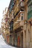 Closed balconies. The traditional closed balconies of  houses of Valletta, capital city of Malta, Europe.  Malta is UNESCO World Heritage Site Stock Photo