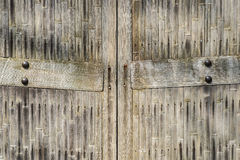 Closed bamboo gates. Closed gates in old and weathered bamboo fence Royalty Free Stock Photos