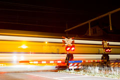 Closed barrier at railway crossing Stock Photography