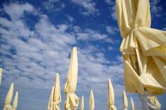 Closed beach umbrellas Royalty Free Stock Images