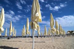 Closed beach umbrellas Royalty Free Stock Photography