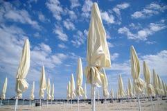 Closed beach umbrellas Stock Photos