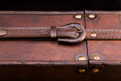 Closed belt on a wooden case. Closed belt on an old woorden wine case royalty free stock image